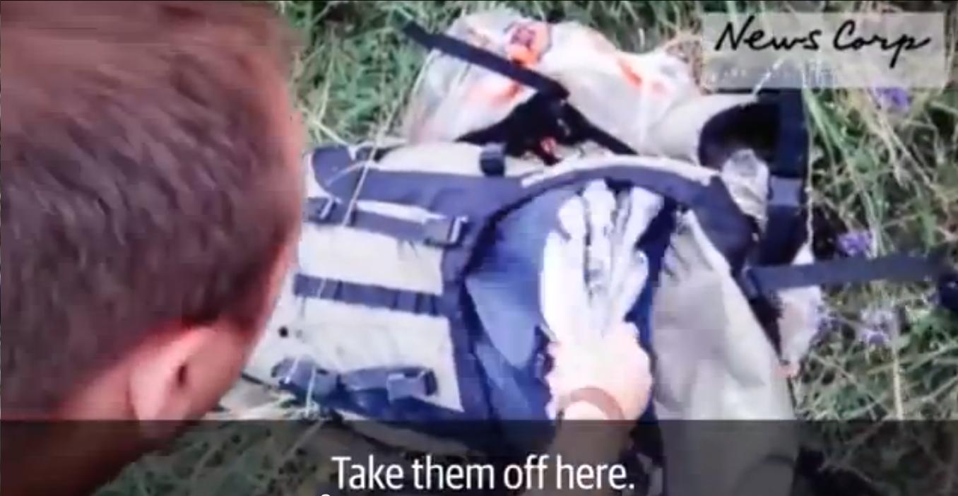 Separatyści na Ukrainie grzebią w bagażach ofiar katastrofy lotniczej (video)