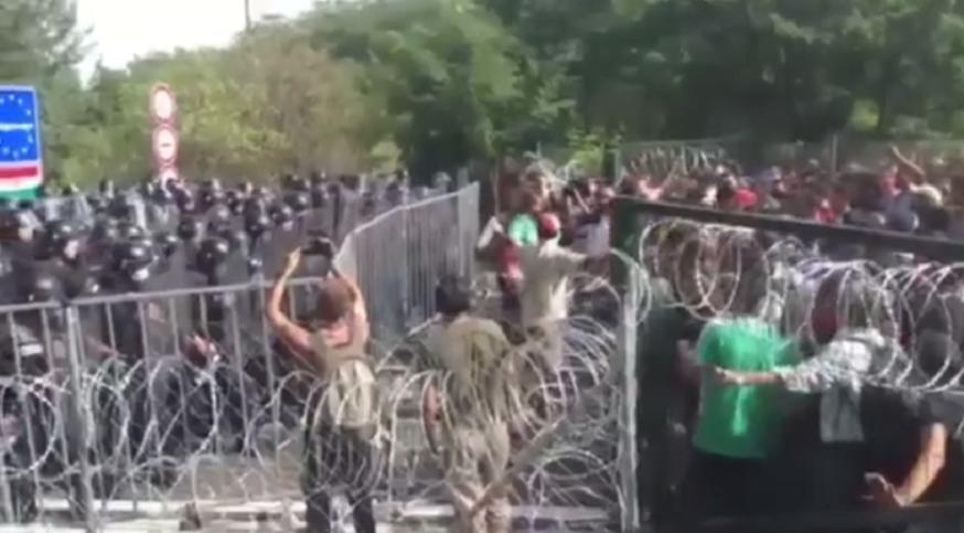 Węgry: trwają starcia imigrantów z policją. Kamienie vs gaz i armatki wodne (video)
